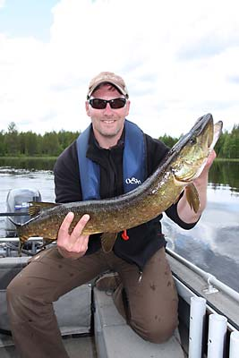 Fishing for giant pike at a wilderness lake